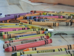 Crayons scattered on white paper